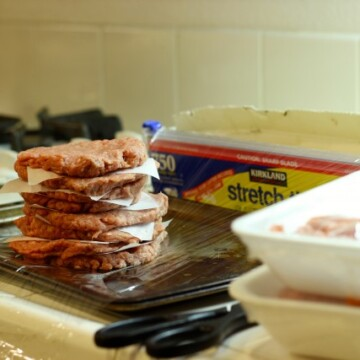 A stack of burgers on plastic wrap