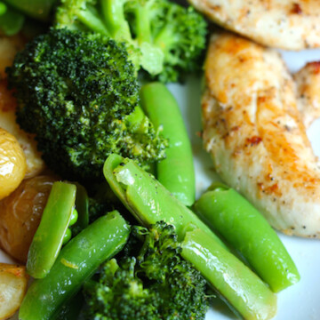 A plate of veggies and chicken