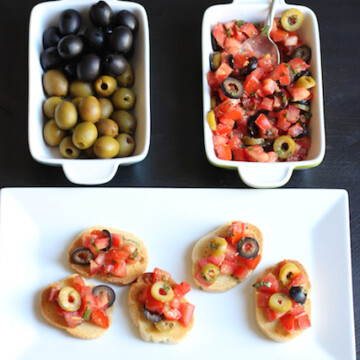dishes of olives and olive bruschetta