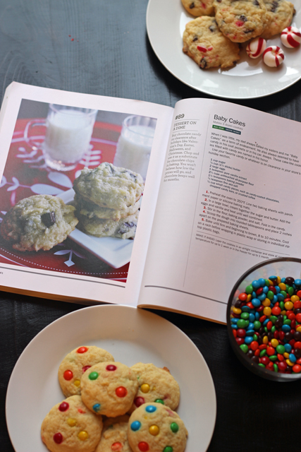 plate of cookies with cookbook and chopped candies