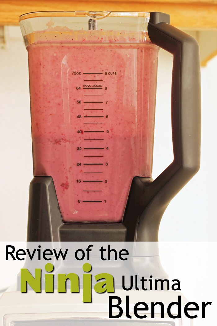pinnable image of the ninja ultima blender full of pink smoothie