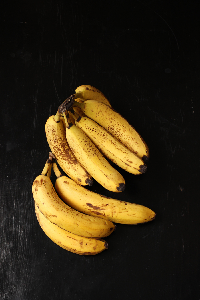 bunches of bananas with brown spots