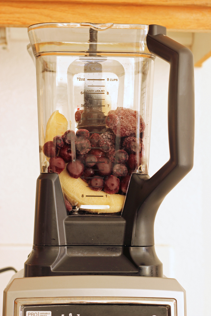 Ninja ultima blender with fruit ready to blend in a smoothie