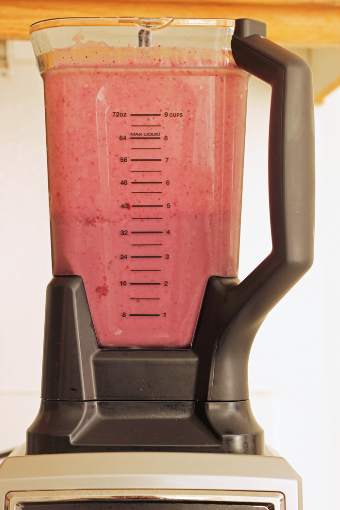 ninja ultima blender full of pink smoothie
