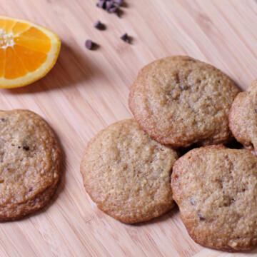 Orange Chocolate Chip cookies on a wood board