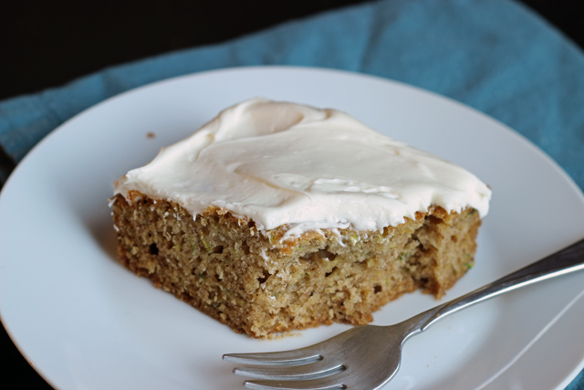 Spiced Zucchini Cake with Cream Cheese Frosting - Bake yourself happy with this spiced zucchini cake topped with a luscious cream cheese frosting.