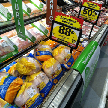 meat department shelves with sale signs