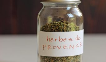 A close up of a bottle of herbs