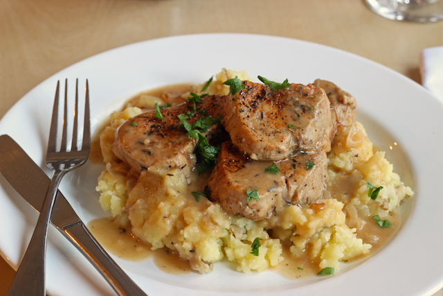 Pork Medallions with Sherried Shallot Sauce - You'll feel like a rockstar chef when you serve up this amazing meal: slices of pork tenderloin bathed in a sherry and shallot sauce atop mashed potatoes. It tastes like a million bucks, but it won't cost you more than ten bucks.