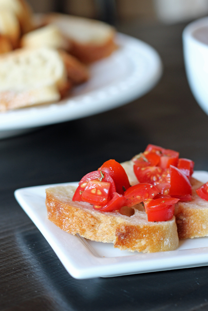 Tomato Bruschetta with Herbes de Provence - This simple tomato bruschetta comes together quickly and easily. It's economical and delicious, the perfect combination for your next company meal.