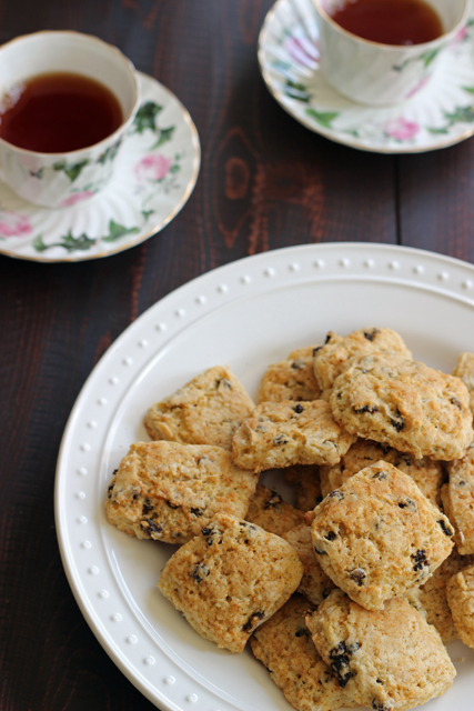 A plate of scones and a cup of tea