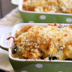 curried chicken and broccoli casserole in green dishes