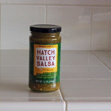 A close up of a bottle of salsa
