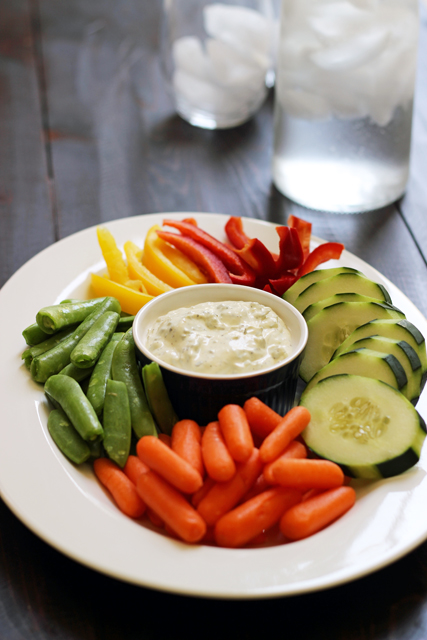 A plate of veggies and dip on a table