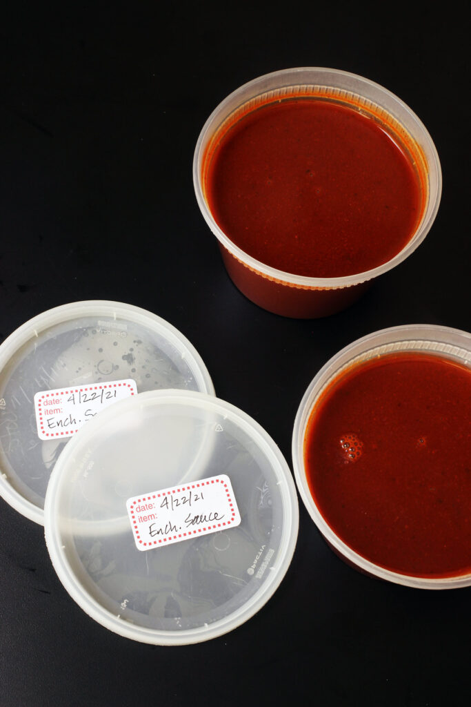 sauce in freezer containers with labeled lids