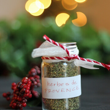 A jar of herbs de provence with twinkle lights