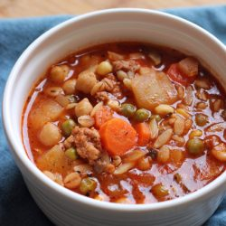 A bowl of Minestrone on napkin