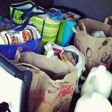 bags of groceries in back of car