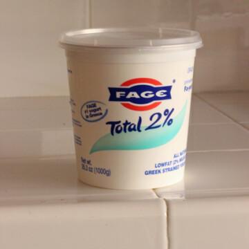 carton of greek yogurt on counter
