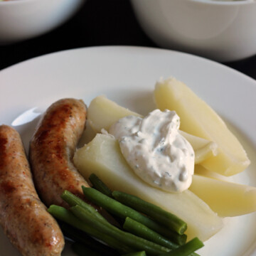 Sausage and Potatoes with Sour Cream Sauce on a plate