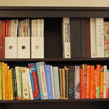 A book shelf filled with cookbooks
