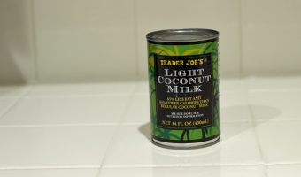 A can of coconut milk on a counter