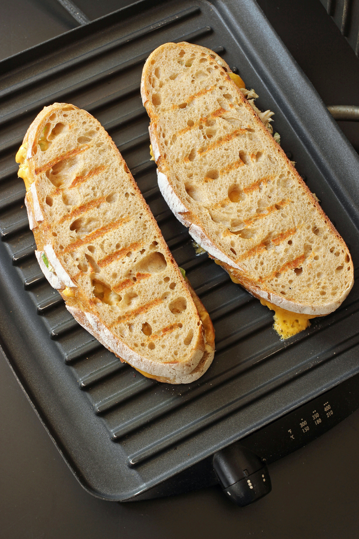 tuna melt cooking on panini press