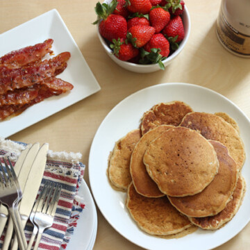 breakfast table with pancakes and bacon