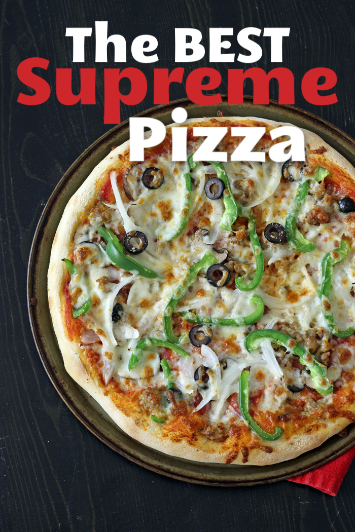 A supreme pizza sitting on top of a pan
