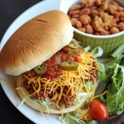 Taco Joe on a plate with salad and beans