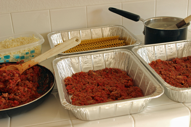 containers prepped with lasagna ingredients for freezing
