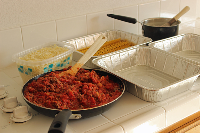 Ingredients and containers on a counter to freeze lasagna
