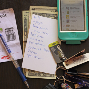 keys, coupons, phone, and grocery list on table