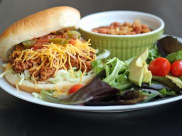 Taco joe on a plate with sides