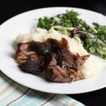 slow cooker pulled pork on dinner plate