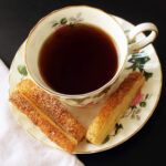 puffs on saucer with cup of tea