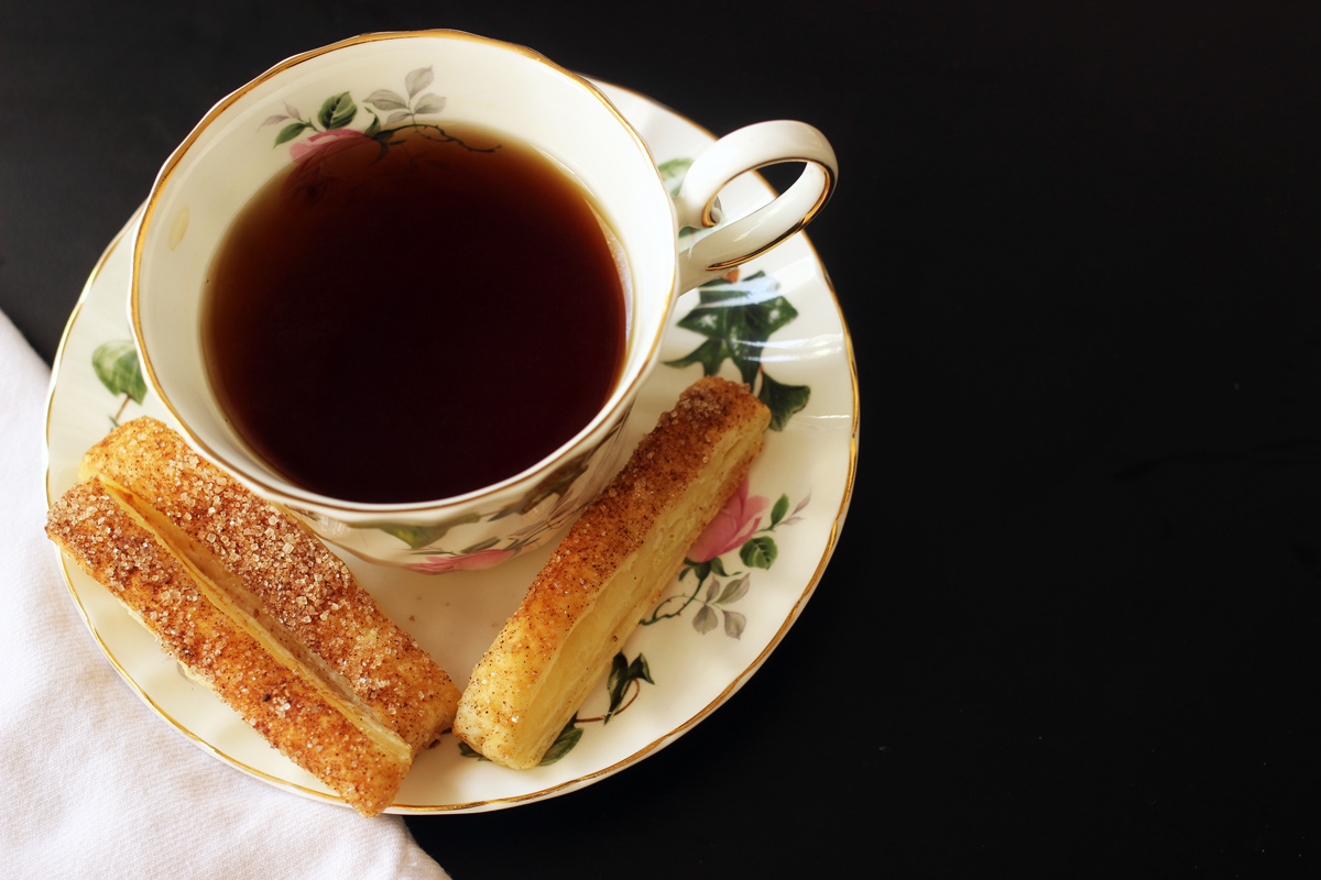 cup of tea with puffs on saucer