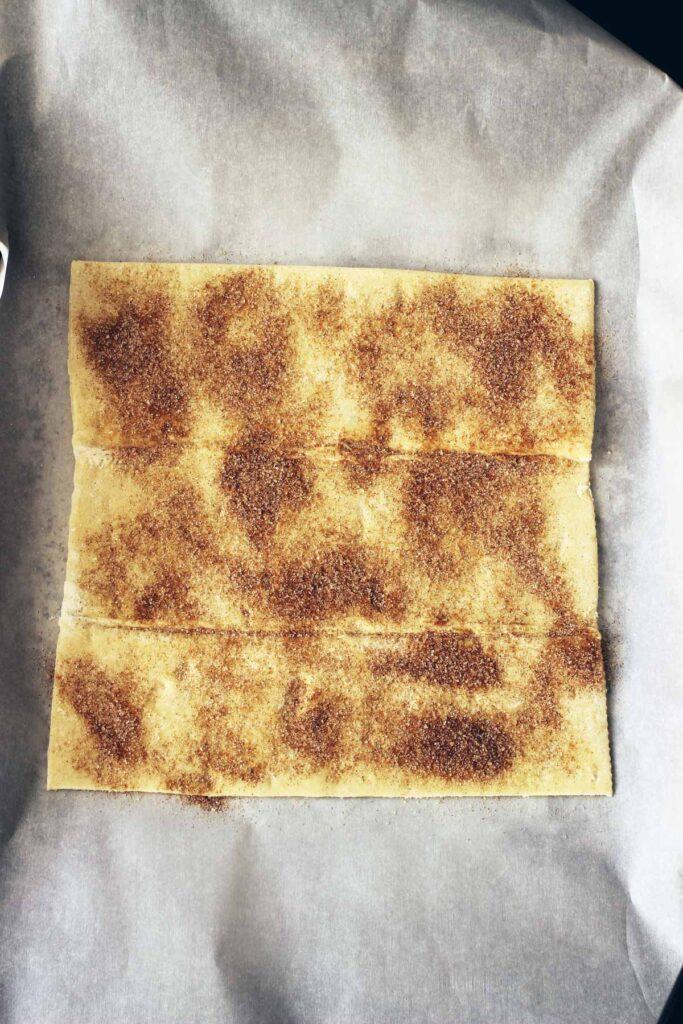 cinnamon sugar sprinkled on pastry