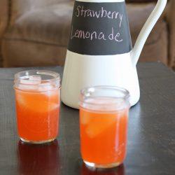 Strawberry Lemonade in mason jars and pitcher