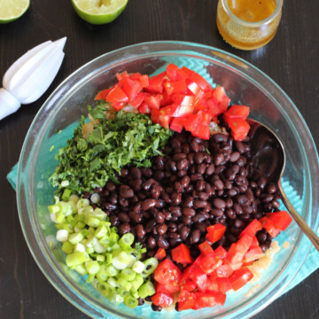 ingredients for rice and beans salad in a glass bowl