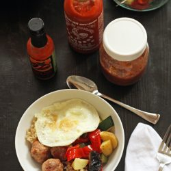 Rice bowl with jars of sauces