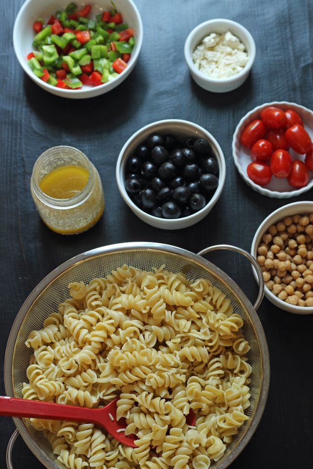 pasta in a bowl with add-ins in separate bowls
