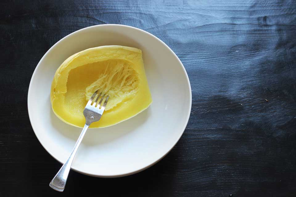 cooked spaghetti squash with a fork