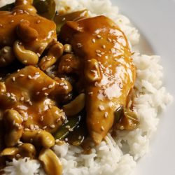A plate of rice and cashew chicken