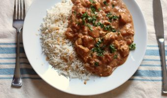 A plate of chicken tikka masala and rice