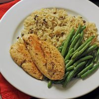 chicken, rice and green beans on a dinner plate
