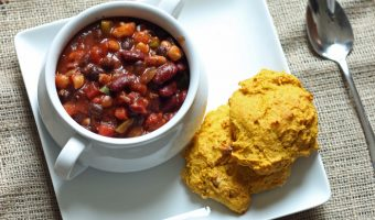 A plate of biscuits with bowl of chili