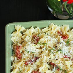 green serving dish with Tomato Brie Pasta