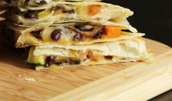 stack of quesadillas with sweet potato and black bean