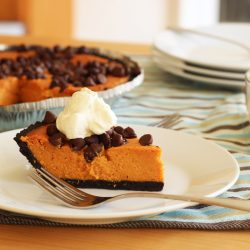 Chocolate chip pumpkin pie on plate with fork